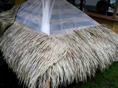 Take outdoor entertaining to new heights by building a backyard tiki bar with bamboo accents and a thatched roof. Tropical Backyard, Backyard Bar, Pool Bar, Tikki Bar, Outdoor Tiki Bar, Outside Bars, Tiki Decor, Tiki Lounge, Bar Design