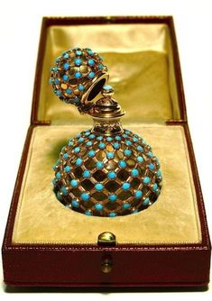 19th c. French 18K Turquoise Jeweled Bottle 19th century French scent bottle, clear crystal ball, 18K gold neck-cover-stopper mount, and basket weave casing, all engraved and set with turquoise, original box. French gold mark. 2 3/4 in.