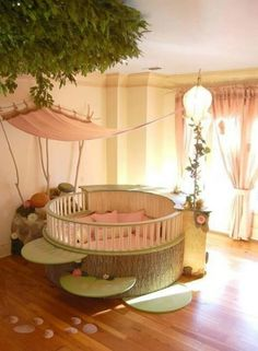 Baby's area---love this. so whimsy. Like a bed for a little fairy. :)