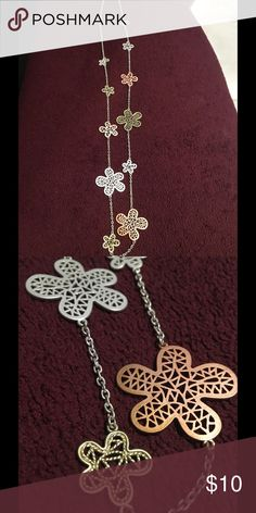 Floral Pink, Gold & Silver Long Necklace Cute metal necklace has a variety of sized flowers colored a rosy pink, matte silver and gold. Jewelry Necklaces