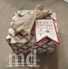 A cute little box made from the envelope punch board and a 6x6 piece of Designer Series paper.