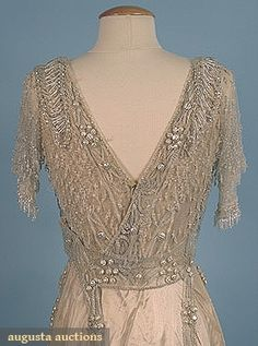 CRYSTAL BEADED TRAINED EVENING GOWN, c. 1909 New Hope, PA 1-piece cream silk satin w/ heavily beaded white tulle over-dress, also decorated w/ faux baroque pearls. Detail