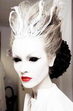 Be an ice queen this Halloween by using a lot of white face paint, black eyeliner, mascara and red lipstick