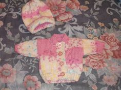 baby girl's cardigan and hat.