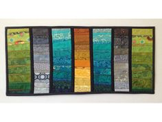 """Small art quilt in summer colors of teal gold green and grey. by AnnBrauer. Sometimes I just have to play with colors and shapes. I call this small quilt """"summer frolic."""" Don't you just love the colors and depth? It is about 11x24 inches. Hmm--I think I may want to explore this theme more."""
