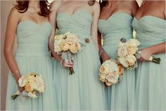 Light blue/teal bridesmaids dresses and flowers