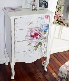 CHEST PAINTED WHITE, LOVELY FLOWER PLACED JUST RIGHT-- GIVES THIS LITTLE PIECE IMPOR- TANCE