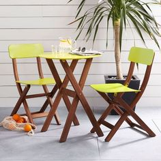 Add a fun pop of color to smaller spaces—including eat-in kitchens + dining rooms—with our metal and eucalyptus wood chairs + café table.