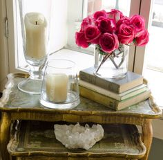 French and feminine decor, pink roses, stone, vintage table, white candles