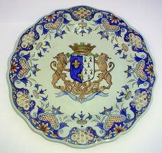 Quimper Porquier-Beau Crest of Brest scalloped plate with classic Rouen decor border. Circa: 1890 France. Photo courtesy of www.countryfrenchpottery.com