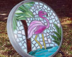 Stained glass and concrete stepping stone. Beautiful, bright stained glass depicting a Flamingo Oasis - The stone is custom made with the stained glass being hand cut and concrete hand poured forming a 14 round stone 2 in depth. Beautiful used as a steppi Stained Glass Birds, Stained Glass Designs, Stained Glass Projects, Stained Glass Patterns, Mosaic Birdbath, Mosaic Garden Art, Mosaic Art, Mosaics, Mosaic Animals