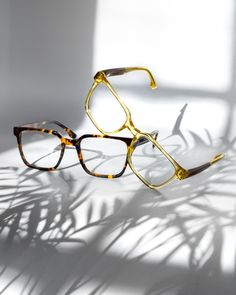 Clothing Photography, Photography Projects, Product Photography, Blurred Lights, Rimless Frames, Glasses Brands, Diamond Face, Cat Eye Frames, Still Life Photography