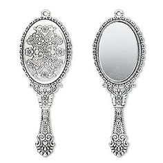 """Realistically rendered in antique silver-plated """"pewter"""" (zinc-based alloy) and decorated with fancy designs, this miniature hand mirror features an oval mirror face."""