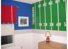 New York Giants Nursery: My husband is a huge New York Giants fan so when we found out that we were having a boy I decided to do a New York Giants theme nursery. My husband loves Boys Football Room, Football Nursery, Football Bedroom, Giants Football, Football Field, Baby Nursery Decor, Nursery Room, Boy Room, Bedroom Wall