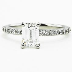 Petite Shared Prong Eternity Engagement Ring with dazzling emerald diamond