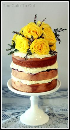3 layers of light vanilla naked cake layered with raspberry jam and fresh cream, topped with fresh oversized yellow roses and greenery. www.facebook.com/toocutetocut
