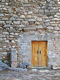 Wooden door at Denia castle in Spain