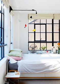 Bed surrounded by windows | The Design Files