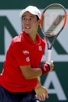 Kei Nishikori of Japan serves to Donald Young during the BNP Paribas Open at the Indian Wells Tennis Garden on March 15, 2017 in Indian Wells, California. - BNP Paribas Open - Day 10