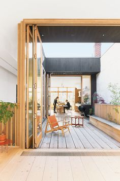 A third-floor courtyard stands in for a backyard and gives Elodie, the couple's two-year-old daughter, a place to play outdoors. A Hunting chair by Børge Mogensen shares the space with a child's chair by  Tomii Takashi and a vintage Danish coffee table.  Photo by: Derek ShaptonCourtesy of: Derek Shapton