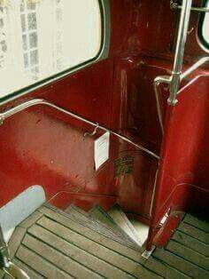 Stairs to the top of a vintage English double-decker bus.