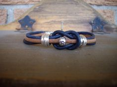 Triple Strand 3mm Distressed Blue and Brown Leather Love Knot Bracelet with Silver Slider Beads by DesignsbyPattiLynn on Etsy