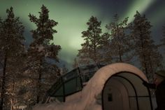 Imagine looking up at the Northern Lights from a cozy hotel room 250 km above the Arctic Circle.