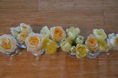 lemon table flowers in mini jars roses,tulips,water lillies