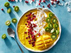 Golden Mango Smoothie Bowl | We love a good green smoothie or breakfast smoothie, and we're particularly fond of the under-250-calories smoothie. You name it, we're blending it. The smoothie bowl, while fairly self-explanatory, is more than just a straw-to-spoon switch. It's the relaxed, sit-down version of an on-the-go smoothie, and arguably a more exciting experience for your tastebuds. Sprinkling it with toppings adds unlimited flavor possibilities, as well as a contrast in texture and a…