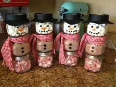 DIY Snowman Jars For Christmas Gifts Snowman made from a baby food jar. The top jar is filled with marshmallows. The middle jar is filled with hot chocolate mix. The bottom jar is filled with mints. Been looking for a craft to do with my baby food jars! Winter Christmas, Christmas Holidays, Christmas Decorations, Christmas Snowman, Christmas Jars, Merry Christmas, Christmas Parties, Christmas Candy, Family Christmas