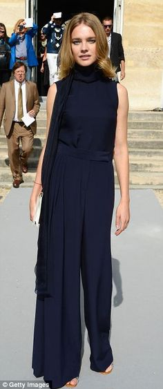 Keeping it simple: Russian model Natalia Vodianova arrives at the Christian Dior show in a bold but understated trouser suit