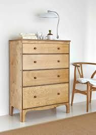 Warren Evans 4 drawer chest in medium oak finish -- like the legs and the simplicity. Will go with my Gordon Russell dressing table but not in a matchy-matchy way...