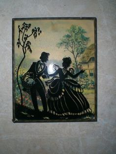 vintage reverse silhouette in bubble glass frame
