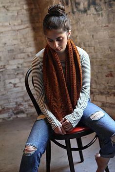 A long cowl is one of my favorite accessories to wear in cooler weather. Worn long in front or wrapped around my neck, this one adds a rich color and texture to any outfit, and it's super cozy to boot.The deep, cinnamon shade of this yarn and the round, squishy fiber really loves this texture pattern, broken up by a few ribs and a simple accent cable at center. The bobble stitch gives a complex, crochet-like quality to the fabric, but it's worked simply by knitting and purling stitche...