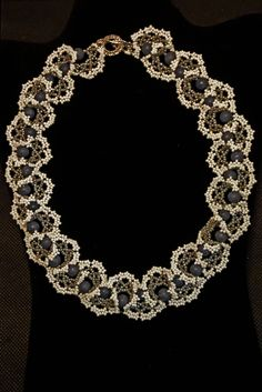 Beaded Ogagala necklace made with Japanese seed beads and accented with natural blue coral beads.