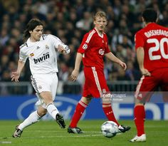 Fernando Gago of Real Madrid (L), Dirk Kuyt (C) and Javier Mascherano (R) of Liverpool in action during the UEFA Champions League First Knockout Round, First Leg match between Real Madrid and Liverpool at the Santiago Bernabeu stadium on February 25, 2009 in Madrid, Spain