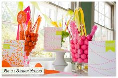 birthday party idea--cluster gumballs, rock candy, lollipops, and ribbon on sticks as party favors