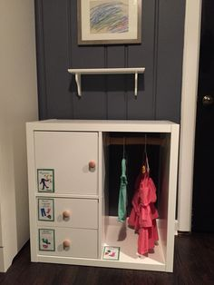 IKEA Hack: KALLAX into toddler closet!  Remove one shelf, turn unit on its side, and then add a dowel to hang clothes. Sold separately are KALKAX inserts to add a cupboard and drawers. :)