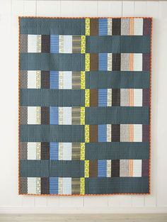 With an alternating arrangement, simple rectangles can create a dynamic quilt. This striking City pattern from Quilt Giving by Deborah Fisher is a perfect project to make and gift as you can easily customize the colors for the recipient.