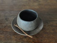 Cup and saucer. Tea, stone, natural, neutral, pottery, ceramics, handmade, dishware, dishes, bowl, plate, spoon.