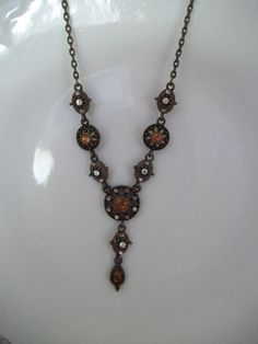Autumn tones make this necklace a must have. Amber/topaz and clear rhinestones in settings on an antiqued chain. Spring closure. I married several vintage pieces together to make this enchanting necklace. Perfect for that special someone who has a November Birthday ♥  Adjustable length: 18 to 20 around with 2 drop.  ----------------------------------------------------------------------------------- Shipping is figured from west to east coast, if you live closer (depending on the weight) it…