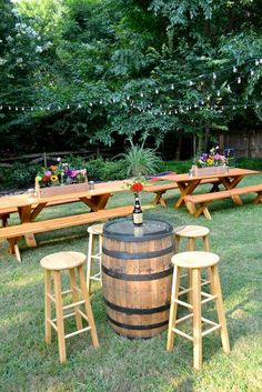Casual Backyard Biergarten Engagement Party: Picnic tables & whiskey barrel bistro tables with pub stools & flowers create a relaxed reception environment. Soirée Bbq, I Do Bbq, Rustic Backyard, Backyard Bbq, Backyard Ideas, Rustic Garden Party, Desert Backyard, Sloped Backyard, Rustic Outdoor
