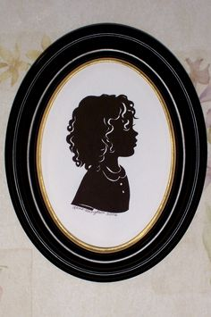 Silhouettes by Lena.  I'm going to get these done of my girls.  From what I've seen online, she does a beautiful job!