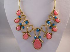 Hey, I found this really awesome Etsy listing at https://www.etsy.com/listing/208262390/gold-tone-bib-necklace-with-pink