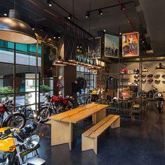 Royal enfield store by lotus, new delhi india motorbike showroom interior design, garage interior Showroom Interior Design, Garage Interior, Interior Exterior, Delhi India, New Delhi, Garage Cafe, Garage Workshop, Garage Shop, Motorcycle Store