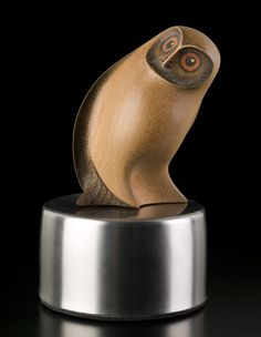 Medium: kauri, stainless steel base. Size: 5 x 3 x 3 inches (incl. base). The Ruru is a kaitiaki (guardian) with the power to protect, advise and warn of death. Rex Homan.