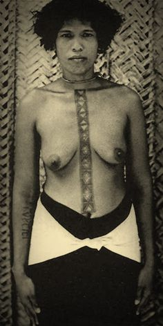 Sikaianese woman with elaborate chest tattoo.