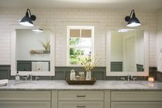 A double vanity is something the Barkers requested, so we did a large double vanity and two separate white framed mirrors with marble countertops.