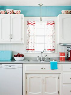 Hints of bright red and sky blue keep this white kitchen feeling fresh. More low-cost cabinet makeovers: http://www.bhg.com/kitchen/cabinets/makeovers/low-cost-kitchen-cabinet-makeovers/?socsrc=bhgpin052913blueandred=7