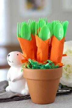 Carrot Napkin Utensils - DIY bushel of carrots for Easter utensils! Green utensils wrapped in an orange napkin to look like carrots.